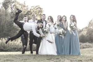 man tripping and flying through air with wedding cake