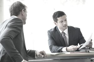 Lawyers discussing an estate at a business desk