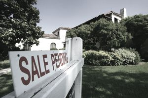 sale pending sign in front of California home