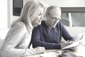 An older couple looking at some paperwork