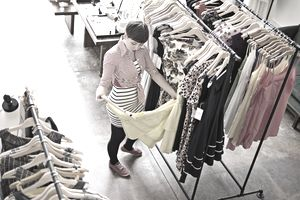 Young female customer shopping for dress
