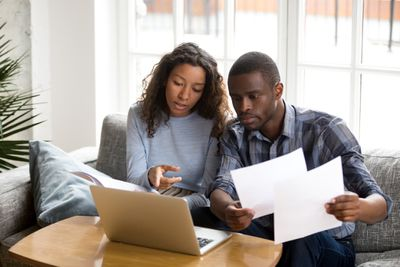 Young Couple With Computer and Documents