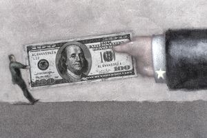 A man plays tug of war with a hundred dollar bill