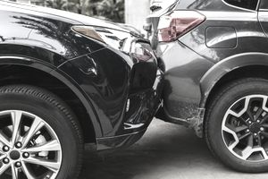 Damaged bumpers from car accident requiring a collision coverage policy.