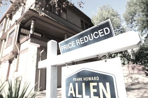 home with priced reduced sign outside