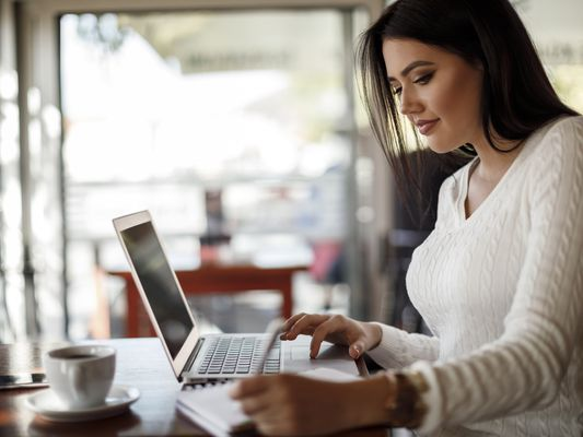 Young woman working at a cafe