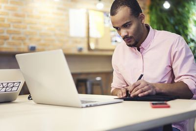 An investor researches a mutual fund at his laptop
