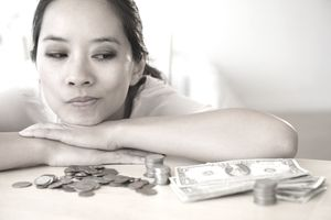 Woman looking at her cash and thinking about how to invest it
