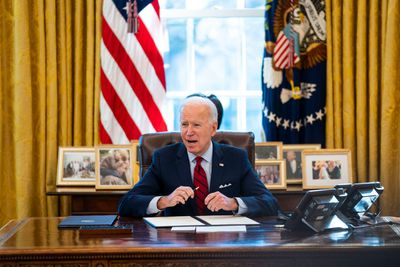 WASHINGTON, DC - JANUARY 28: U.S. President Joe Biden signs executive actions in the Oval Office of the White House on January 28, 2021 in Washington, DC. President Biden signed a series of executive actions Thursday afternoon aimed at expanding access to health care, including re-opening enrollment for health care offered through the federal marketplace created under the Affordable Care Act.