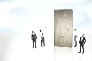 Business men surrounding a large credit card