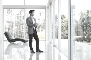 a young businessman looking out a window