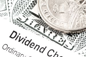 Close Up Of Shares Certificate Dividend Check And A 1 Coin