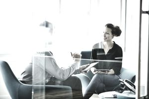 A young woman meets with a financial planner to discuss early retirement.