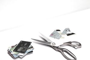 Cutting credit cards is a way to stop collecting debt.