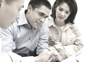Couple purchasing securities from their financial advisor.