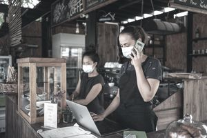 Masked Women Working in Cafe