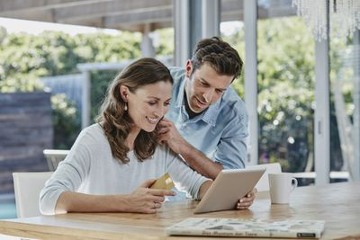 Couple making their mortgage payment online with a credit card