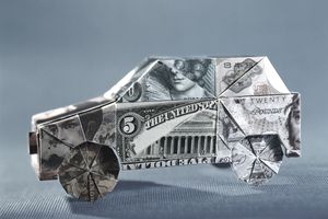 World currency origami car, close-up