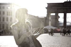 Woman viewing map while traveling