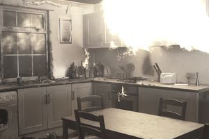Fire raging in domestic kitchen at nigh