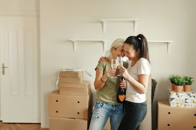A young couple celebrates on move-in day.