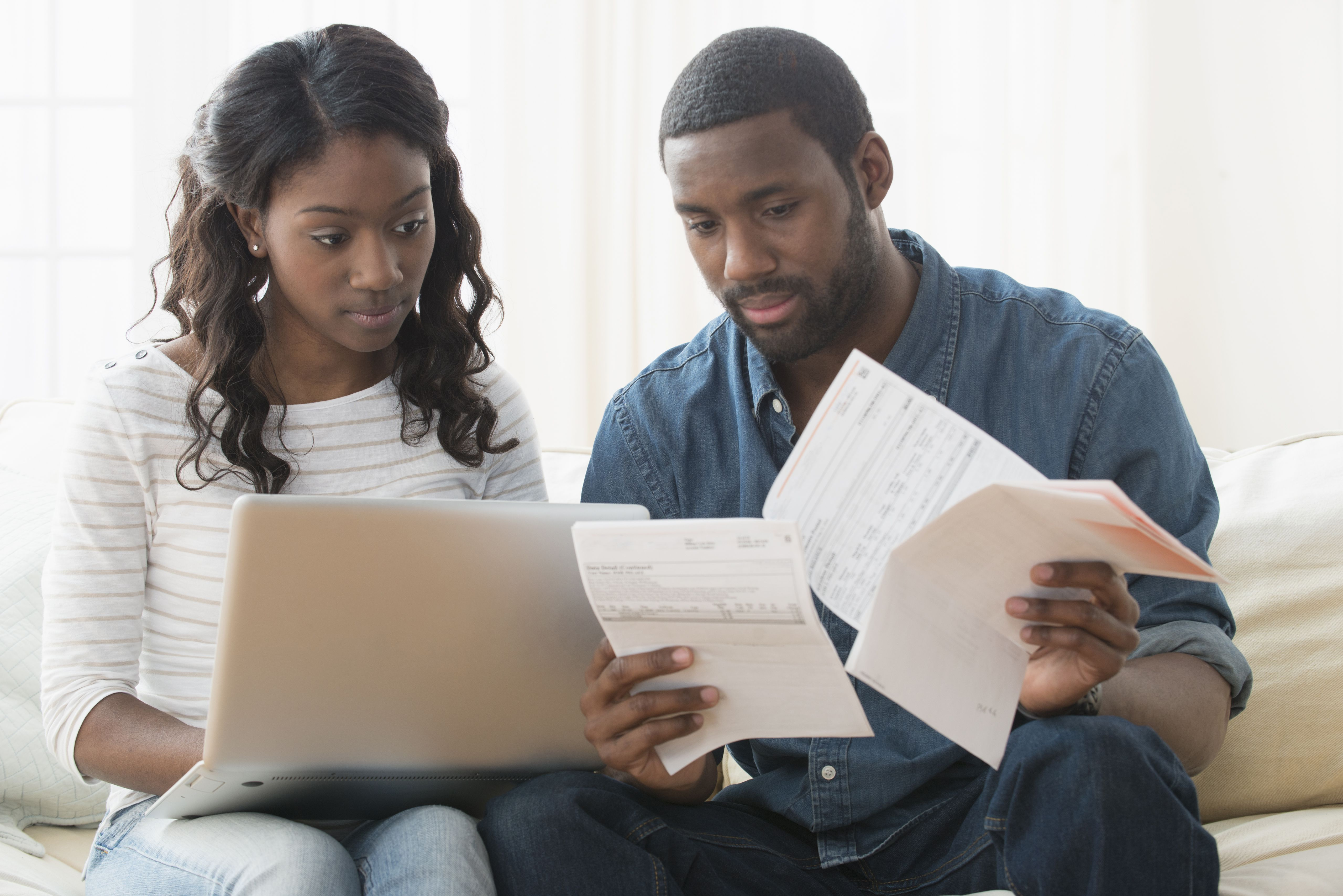 Couple worrying over the bills they have to pay for the month