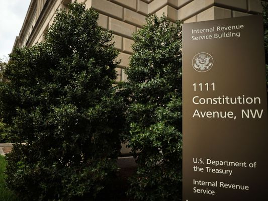 Photo of the exterior of the IRS building in Washington. The close-up of the sign shows