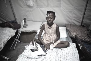 Haitian earthquake survivor Rosena Favecal recovers at the Red Cross medical observation tent inside General Hospital