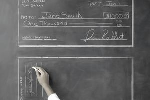 Woman Signing Blackboard Check