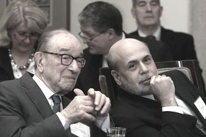 Federal Reserve Board Chairman Ben Bernanke (R) chats with former Federal Reserve Chairman Alan Greenspan during the Federal Reserve centennial commemoration at the Federal Reserve building, on December 16, 2013 in Washington, DC.