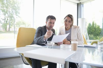 A real estate agent discussing paperwork with a buyer