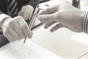 Person signing a loan application at a Credit Union.