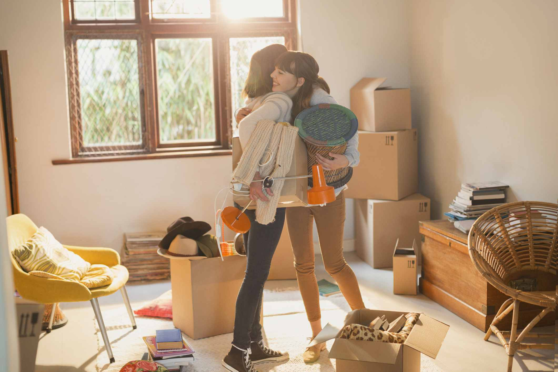 Mother and daughter hugging in a college dorm