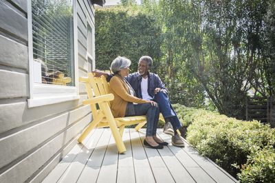 Retired baby boomers sitting on a front porch