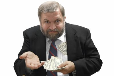 Debt collector putting his hand out for more money