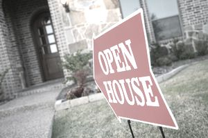 Open House sign pointing to a home that is back on the market.