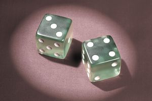 Two dice on a red background, representing the gamble that is shorting stock.