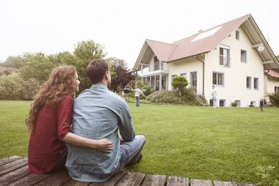Couple in yard looking at house