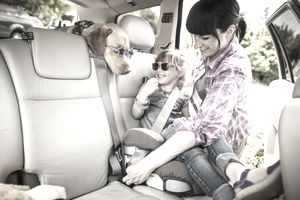 Mother Putting Daughter in Car