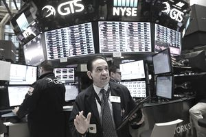 Traders work on the floor of the New York Stock Exchange (NYSE) on February 6, 2018 in New York City. Following Monday's over 1000 point drop, the Dow Jones Industrial Average briefly fell over 500 points in morning trading.