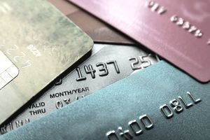 A stack of multicolored credit cards is in close-up view.