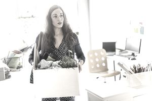Businesswoman carrying cardboard box in office