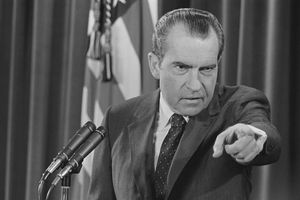 President Richard Nixon points at a reporter during a press conference.