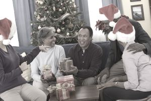 A group of people exchanging holiday gifts.