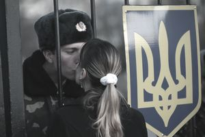 Ukraine soldier kissing woman