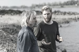 a father and son talking