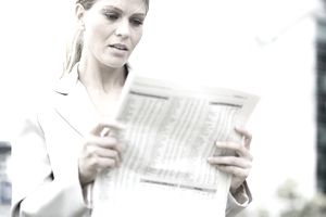 Woman looking at stock reports