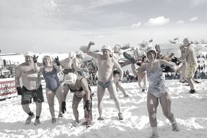 Older people playing in the snow in bathing suits at the Quebec Winter Carnival