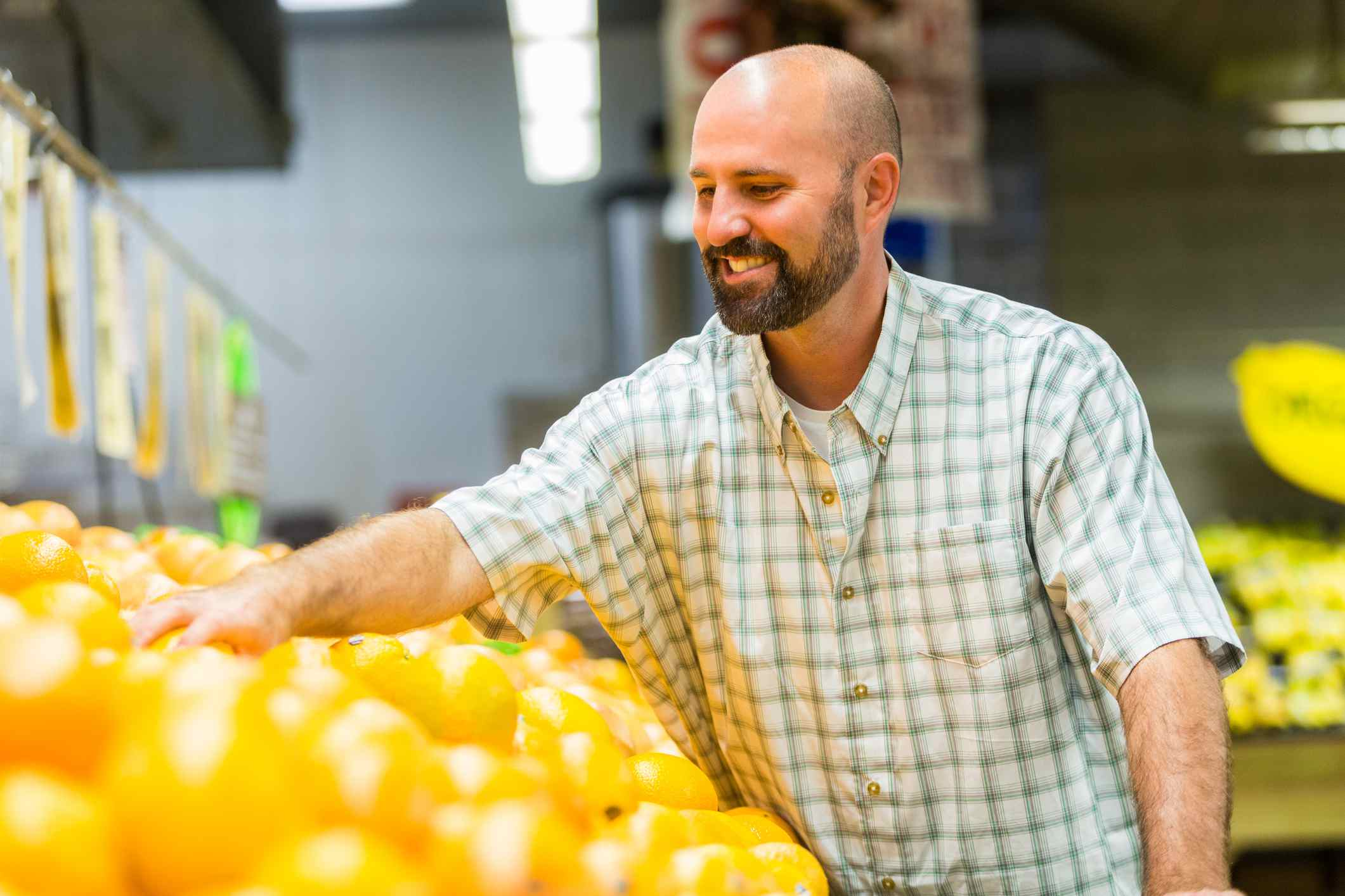 man spending ARRA tax cuts on yellow peppers
