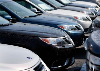 Rows of cars for sale at a dealers lot
